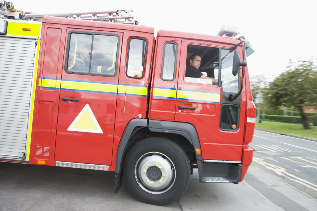 Fire Safety. A fire engine leaving the fire station